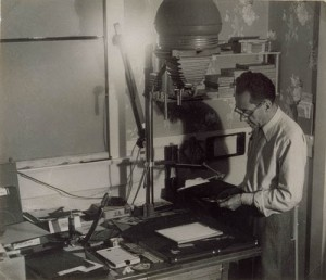 man-ray-standing-in-darkroom